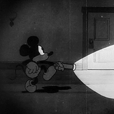 Mickey avec une lampe torche